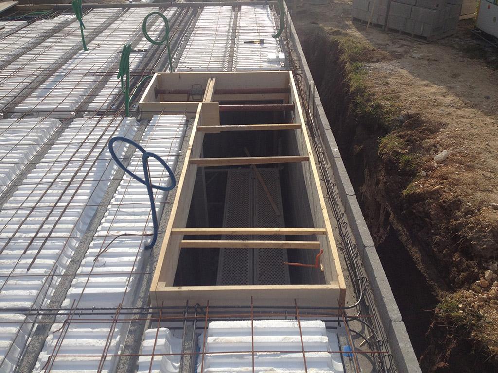 Construction d'un pavillon – Préparation du plancher béton